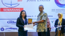 One of the authors, Janette Salvatus, as she receives the Best Paper Award in IEEE COMNETSAT 2017 in Indonesia